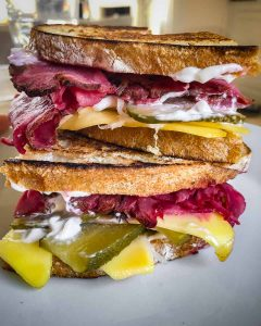 vegan pastrami in a reuben sandwich
