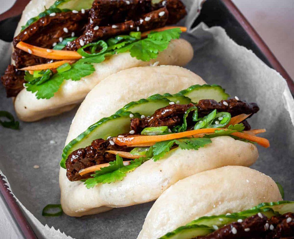 three delicious vegan bao buns