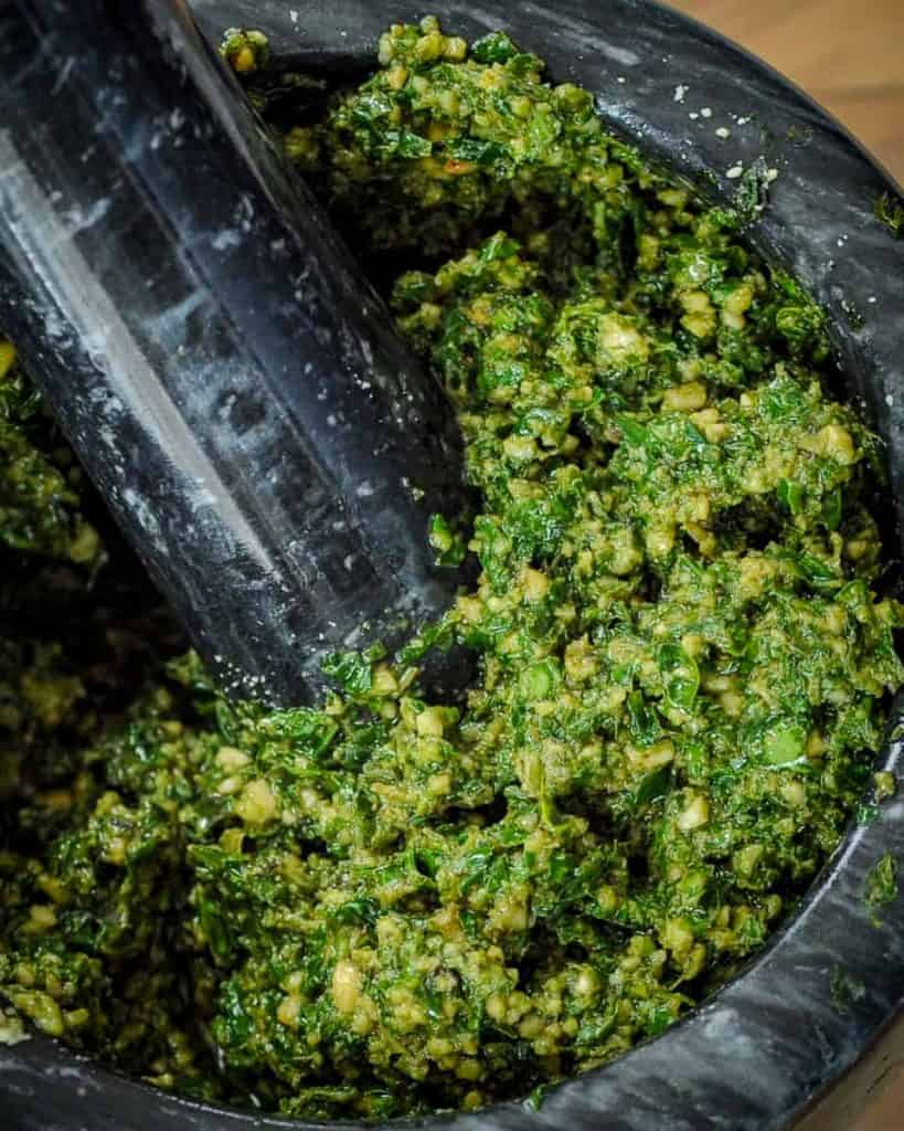 chunky pesto in a mortar