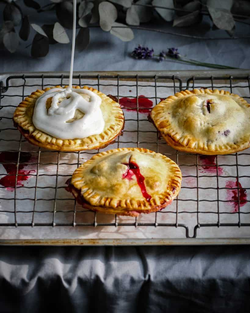 glazing the blackberry hand pies