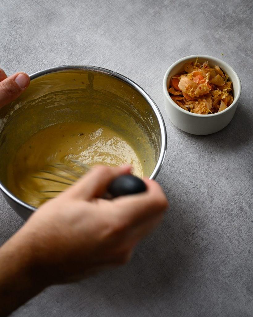 adding kimchi to the pancake batter