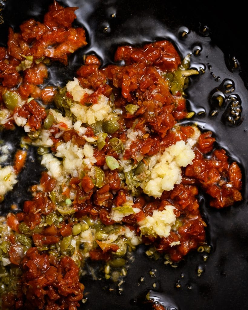 garlic, sun-dried tomatoes and capers